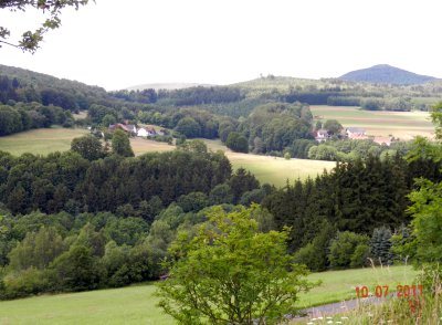 View from the forest to the farm on the Auersberge