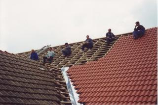 Workers on the roof make a break