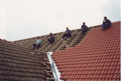 Helpers wait for the next roof tiles