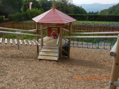 Playground with climbing frame and slide
