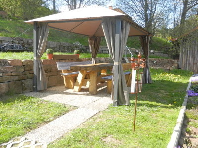 Seating in the garden under the gazebo